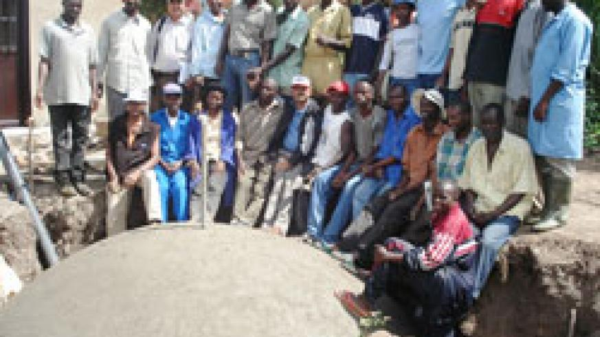 Biogas technicians pose for a group picture with residents of Eastern Province (Photo; S. Rwembeho)