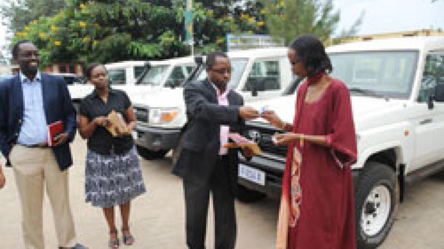 Dr. Fidel Ngabo (2nd right) during the hand over of vehicles to representatives of NGOs. Looking on are Dr. Daniel Ngamije (L) and Dr. Corine Karema (Photo; J. Mbanda)