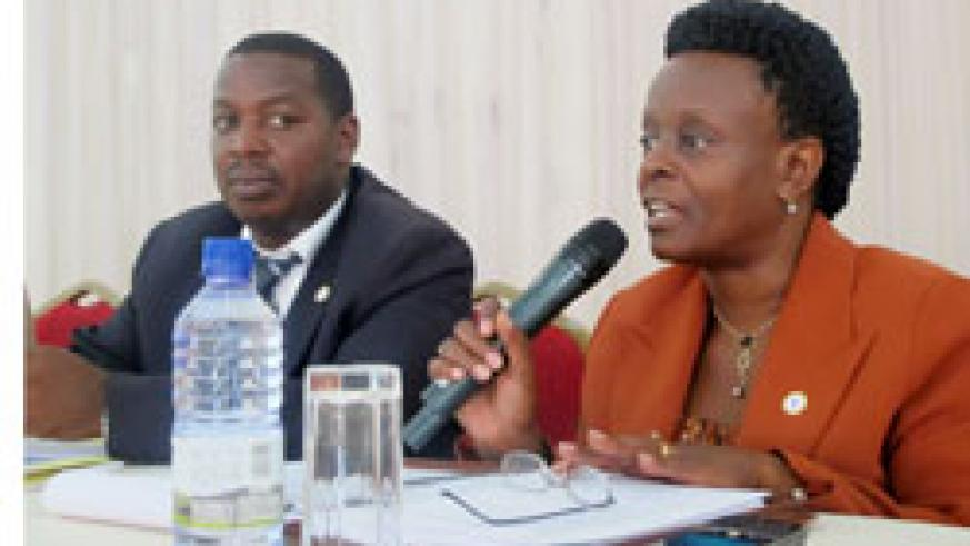 The Permanent Secretary in the Ministry of Infrastructure, Marie Claire Mukasine (R) and  Cyrille Turatsinze during the meeting (Photo; T. Kisambira)