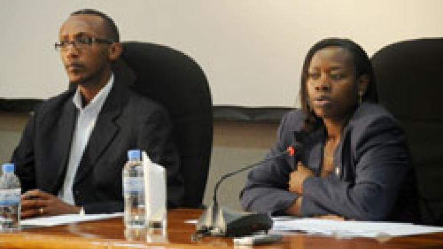 Trade and Industry Minister, Monique Nsanzabaganwa, (R) with Regis Gatarayiha, the Acting Director of RURA, during a talk show on the mounting fuel prices at Telcom House, Kigali.