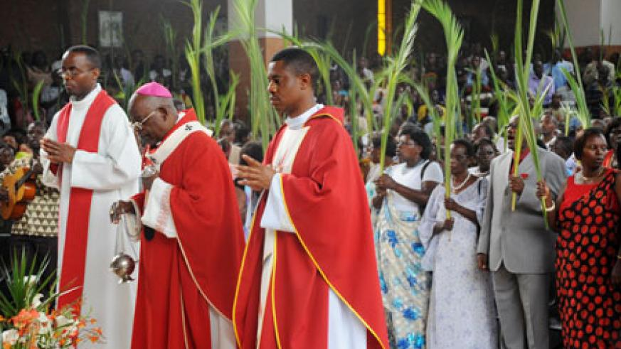 The Archbishop of Kigali Diocese, Thaddée Ntihinyurwa (C) leads worshippers in the Palm Sunday mass at St Michael's Church in Kigali.  (Photo T.Kisambira)
