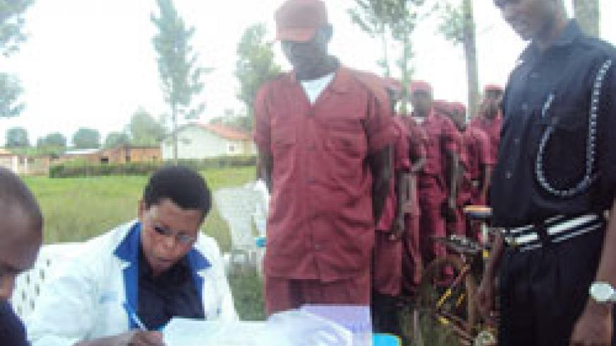 Local Defense personnel queue for voluntary HIV testing and couselling  in Rwamagana. (Photo by S. Rwembeho)