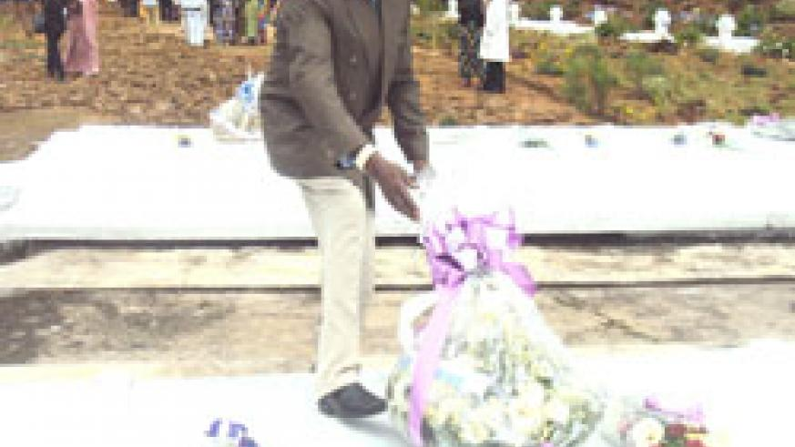 RIP Alloys Rwamasirabo lays a wreath at the mass grave in which remains of his nine children were laid to rest (Photo/ S Nkurunziza