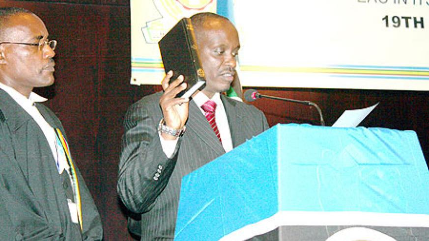 Dr Sezibera takes oath after being appointed new EAC Secretary General, yesterday. (Courtesy Photo).