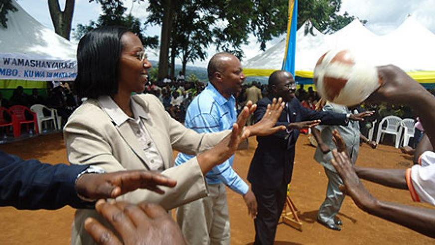 Dignitaries share the joy that came with connecting  Nkombo to the national electricty grid. (Photo L. Nakayima)