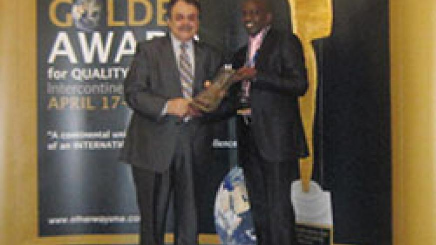 Januario Mucyo (right) receives the Golden Award on behalf of BK, in Germany. (Courtesy Photo)