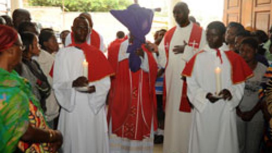 Catholic Priests lead worshippers at Regina Pacis in Remera to observe the Way of the Cross procession (Photo T.Kisambira).