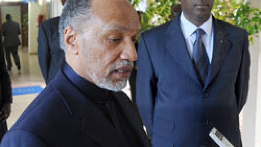 Mohamed Bin Hammam adressing the press during his visit to Rwanda. Looking on his Prime Minister Bernard Makuza. (File Photo).
