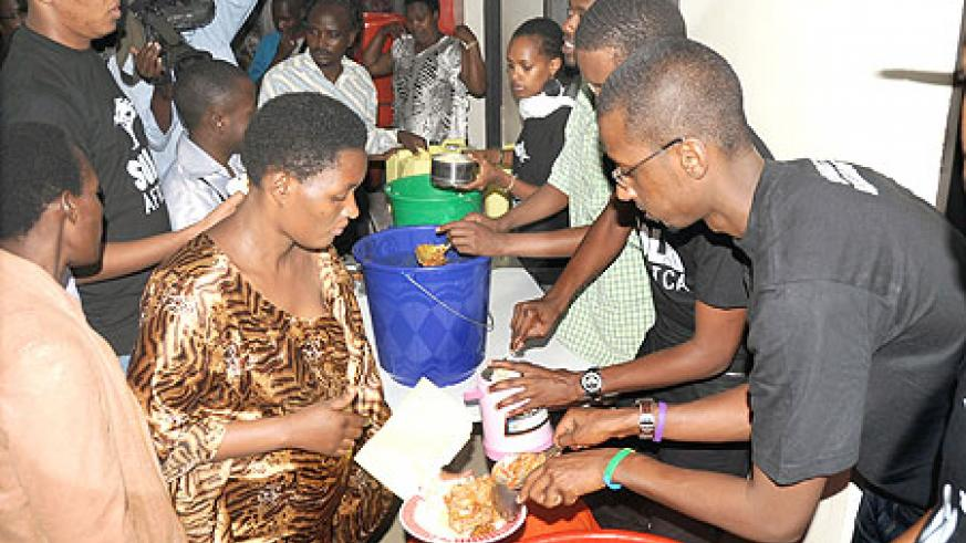 Members of Solid Africa share food with patients at CHUK Hospital, yesterday. (Photo: J. Mbanda)