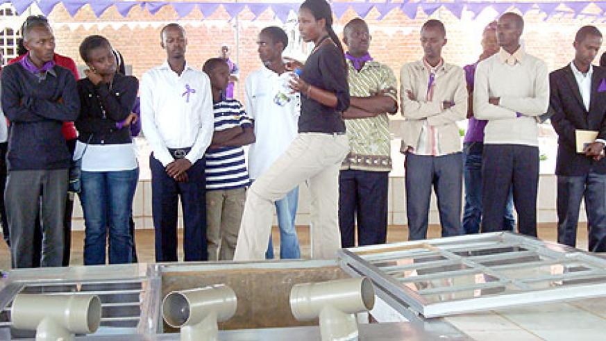 The Kimironko youth listen to a guide at Nyamata Genocide Memorial site.(Photo G. Mugoya)