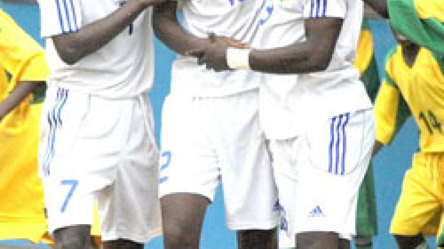 Justin Mico (C) is  mobbed by teammates during the 2011 Africa U-17 Championship. He is expected to lead Rwanda's attack today. (File Photo)