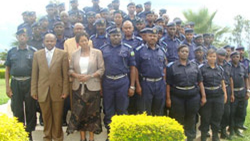 Police officers and RIAM and capacity building secretariat officials pose for a group photo after the opening of the training.