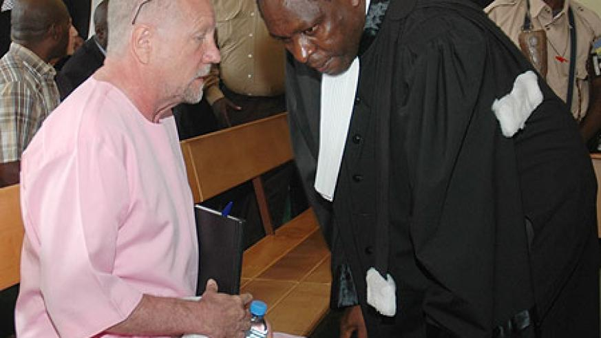 Peter Erlinder discussing with his lawyers at the High Court (File Photo)