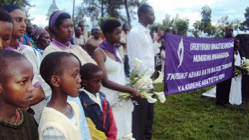 Youth survivors conduct prayers at the Rwamagana memorial  site moments before they took part in a five kilometre walk (Photo by S. Rwembeho).