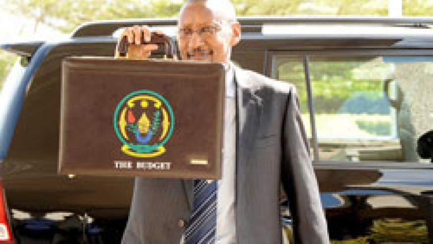 Fiinance Minister, John Rwangombwa, heading to Parliament to present the National Budget for the FY 2010-11 (File photo)