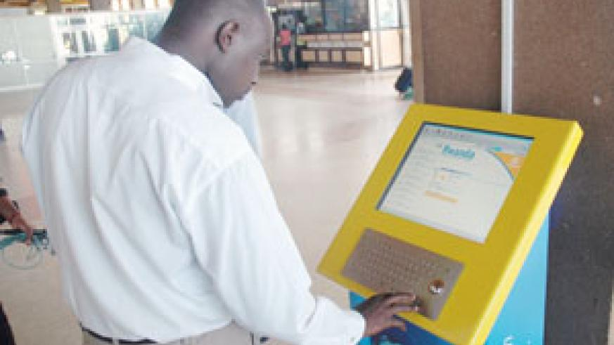A man surfs the internet from a display Kiosk. Similar facilities will be installed at courthouses. (File photo)