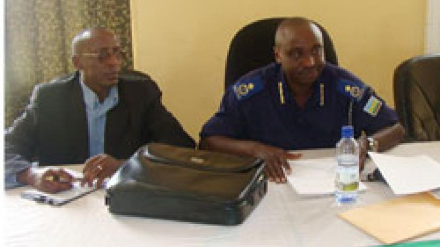 Assistant Commissioner of Police Vianney Nshimiyimana and Emmanuel Karara of Small Arms and Light Weapons Management during the training. (Courtesy photo)