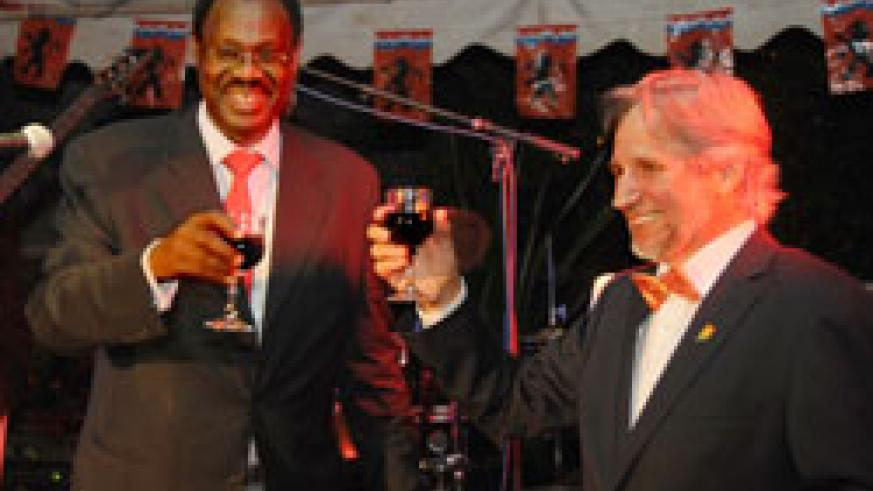 The Dutch Ambassador to Rwanda Frans Makken (R) tosses a glass of wine with Ambassador Ben Rutsinga during the celebrations to mark the Queens Day (Photo T.Kisambira).