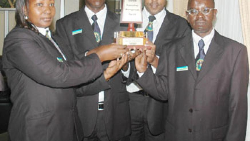 Immigration staff with an award they one for exceptional services. (File Photo)