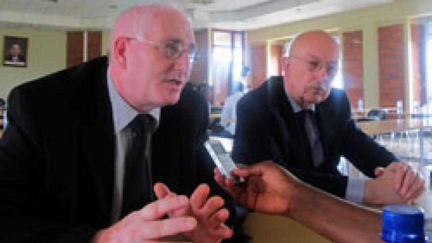 (L-R)Helmut R.Schrader, Senior Advisor of Germany-African Business Association and Jurgen Reese the Sales Manager of Nsido (Photo T.Kisambira).