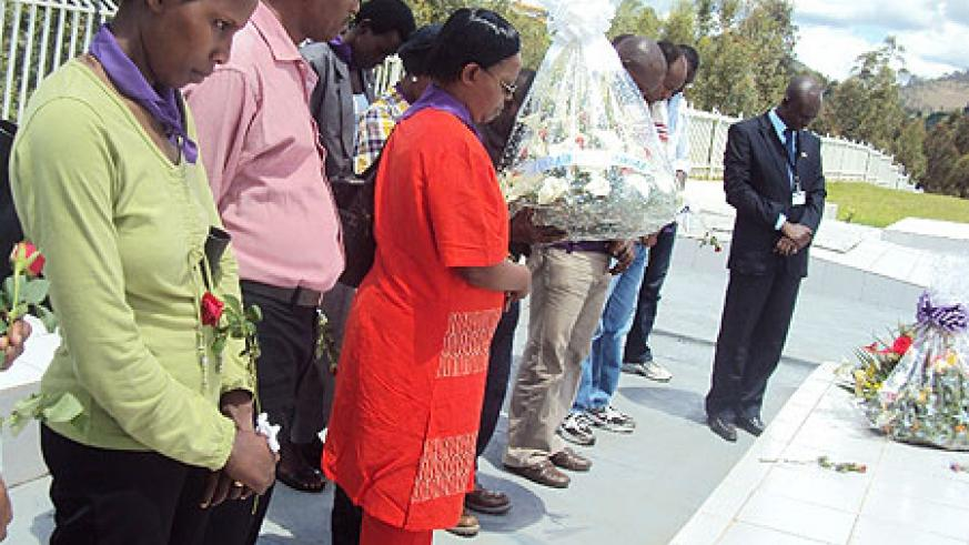 AGF staff members pay tribute to genocide victims buried at Murambi site (Photo Bucyensenge