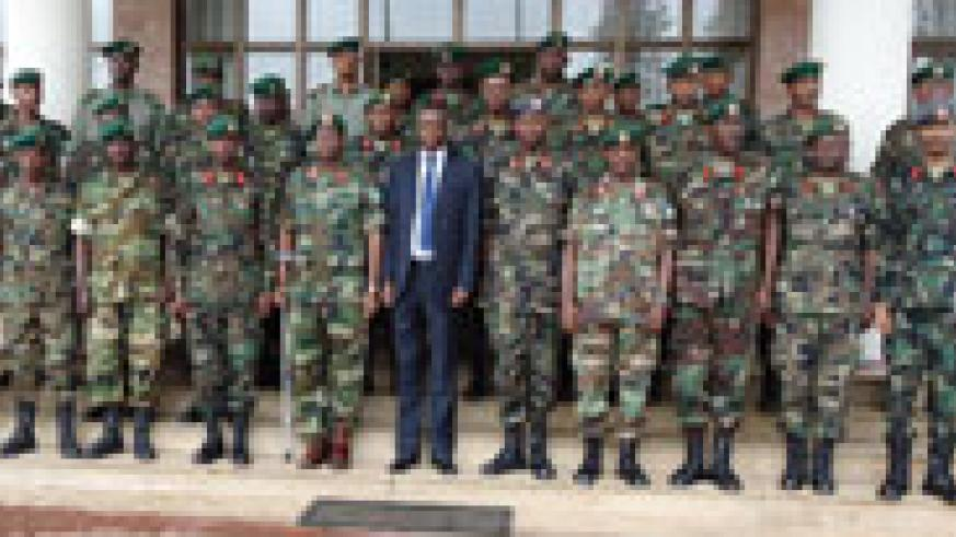 The Military judges and prosecutors in a group photo with Defence Minister Gen James Kabarebe (in suit) after opening the induction course, yesterday (Courtsey Photo).