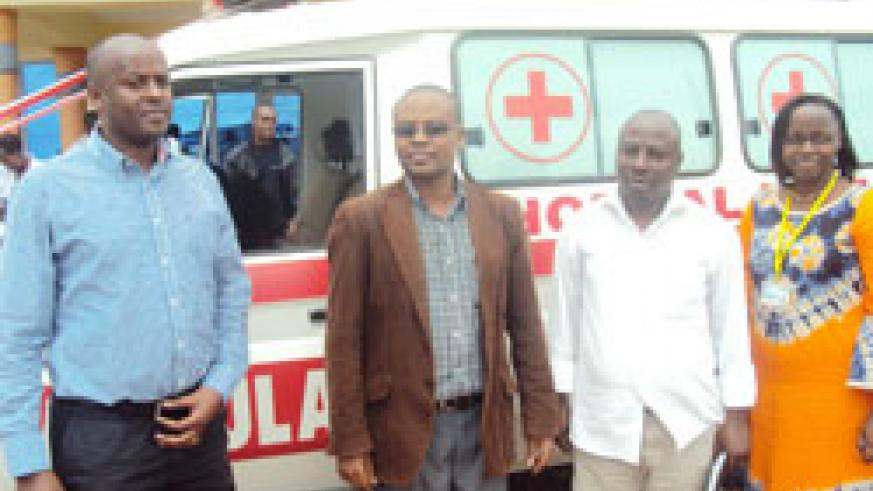 Mayor Protais Murayira (2nd L) with PIH officials after receiving the two ambulances [1]. Photo by S. Rwembeho.