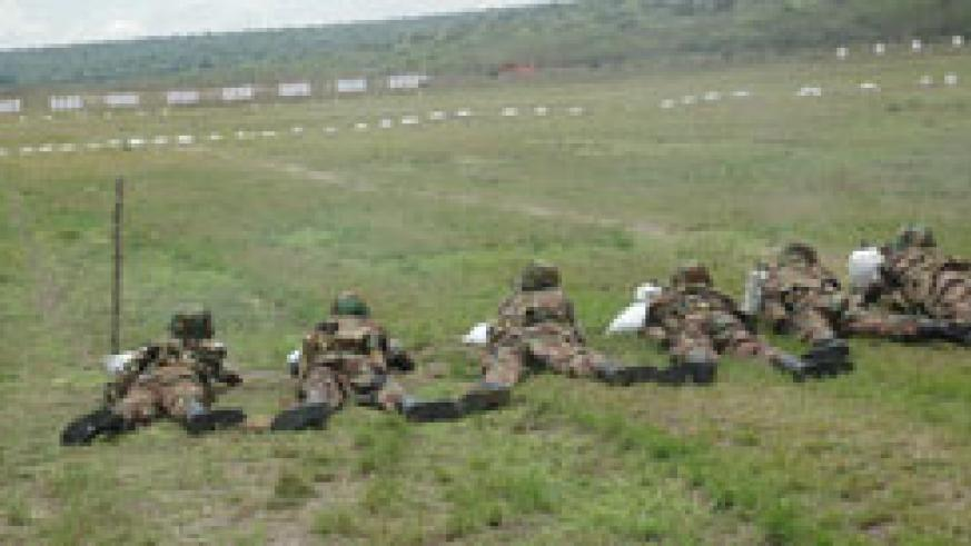 RDF soldiers in a shooting exercise. Rwanda will, in October, host a regional command post exercise (File Photo).