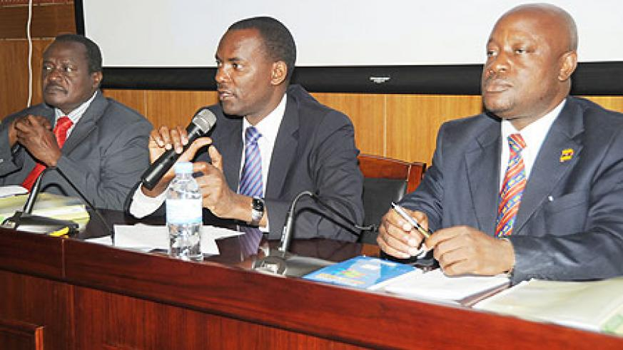 The Permanent Secretary in the Ministry of EAC  (C), Robert Ssali, addresses the EALA legislators.Looking on are EALA MPs Otieno Karan (L) and  Mike Sebalu. (Photo J Mbanda)
