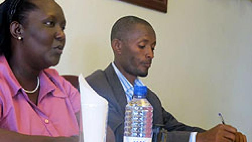 (L-R)Domitilla Mukantaganzwa, head of Gacaca Commission, together with Denis Bikesha, the officer  in charge of training during the news conference yesterday (Photo T.Kisambira)