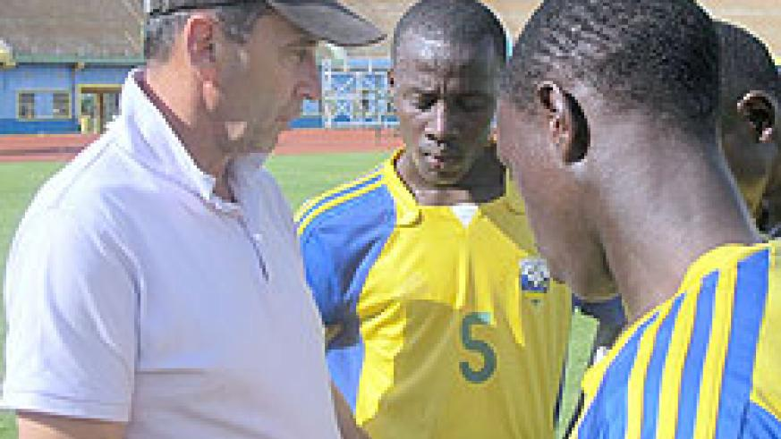 Richard Tardy (L) talks to his players after a training session. (File Photo)