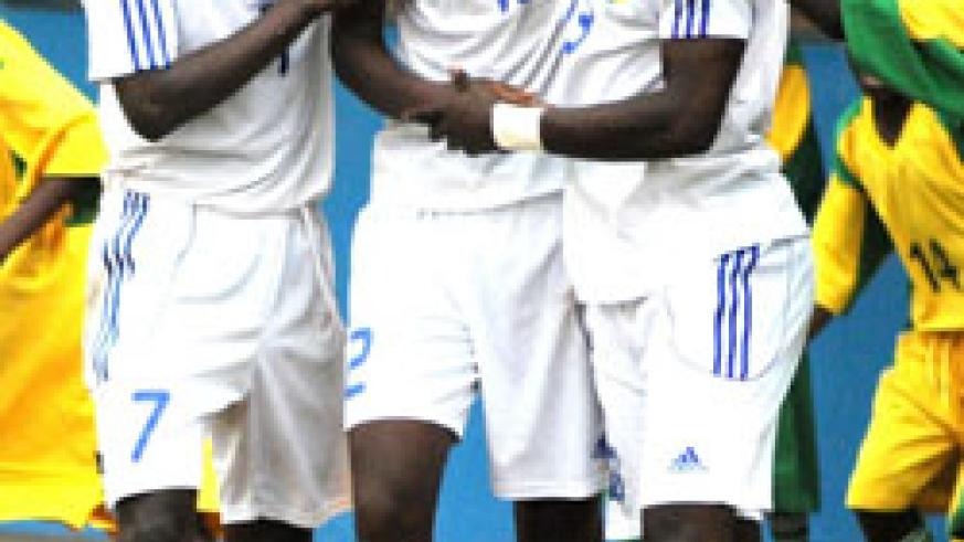 Justin Mico (C) is  mobbed by teammates during the 2011 Africa U-17 Championship. (File photo)