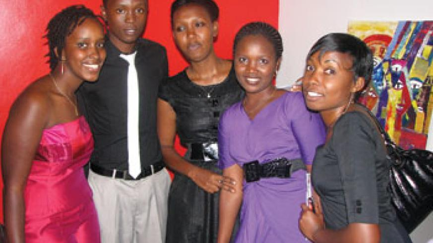 Akaliza Gara stands strong with her four employees; one secretary and three Web Developers.
