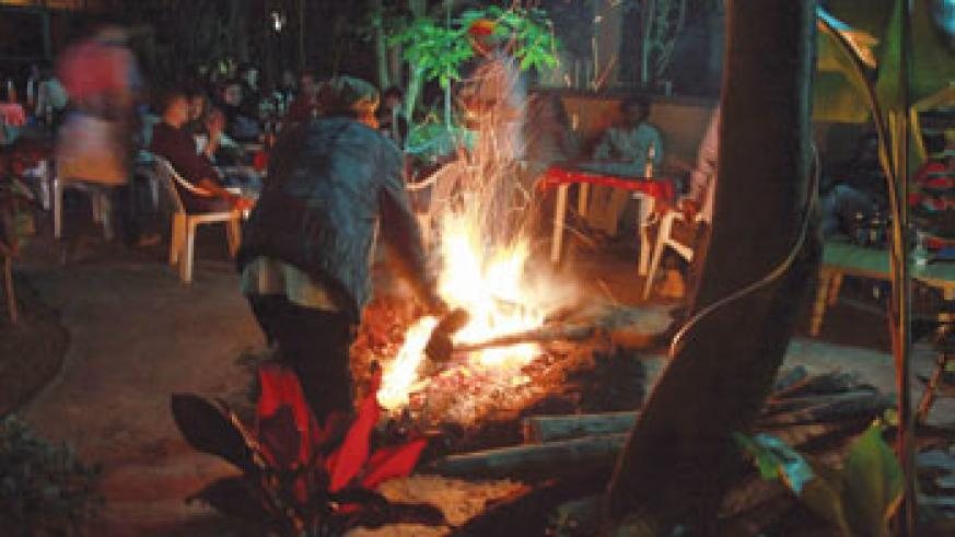 A reggae enthusiast makes bonfire to shed of a cold night