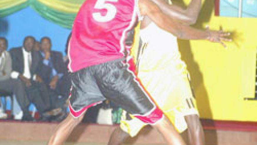 Fiston Muhire (with the ball) tries to shield off a Burundi player during the 2008 Zone 5 Championship. (File photo)