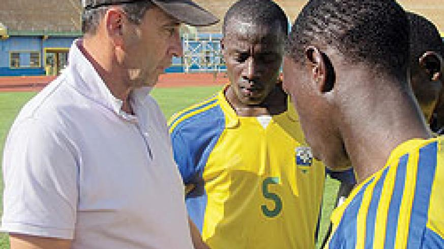 Richard Tardy explaining some thing to his players after an intensive workout at Amahoro Stadium. (File photo)