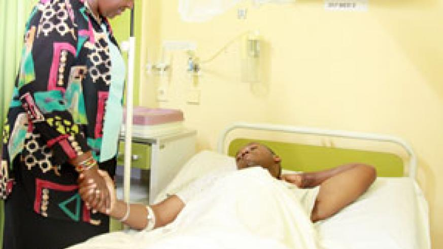 Minister of Health, Dr. Agnes  Binagwaho comforts an accident victim at King Faisal Hospital (File Photo)