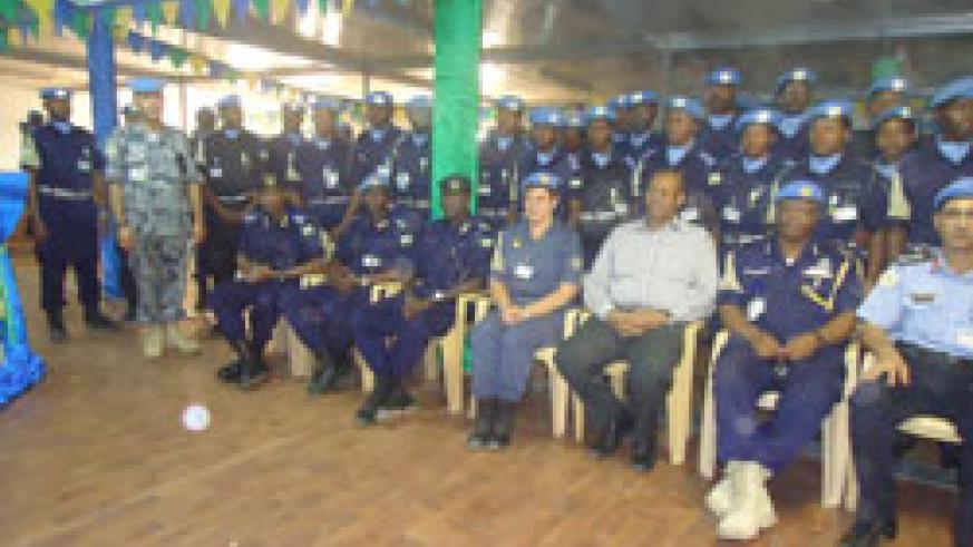 Some of the awarded Rwandan  police officers pose for a group photo with the dignitaries who attended the event (Courtsey Photo).
