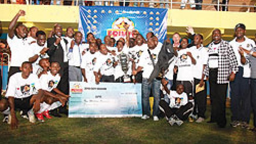 APR Players and Team Officials with their League trophy and 10m  frw cheque.(Photo / T. Kisambira).