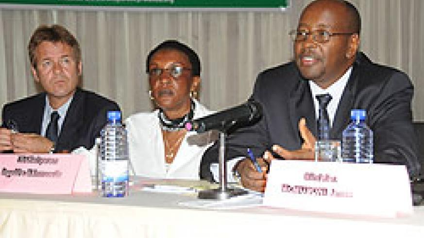 Minister James Musoni (R) speaks at the launch of the 2010 Bribery Index. With   him are Transparency Rwanda Chairperson Marie Immaculee Ingabire (C) and William Atkins from Norwegian People's Aid. (J Mbanda)