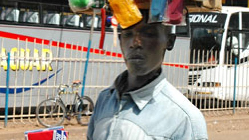 A hawker in a Kigali street. Traders have lamented hawkers are killing their businesses (File Photo).