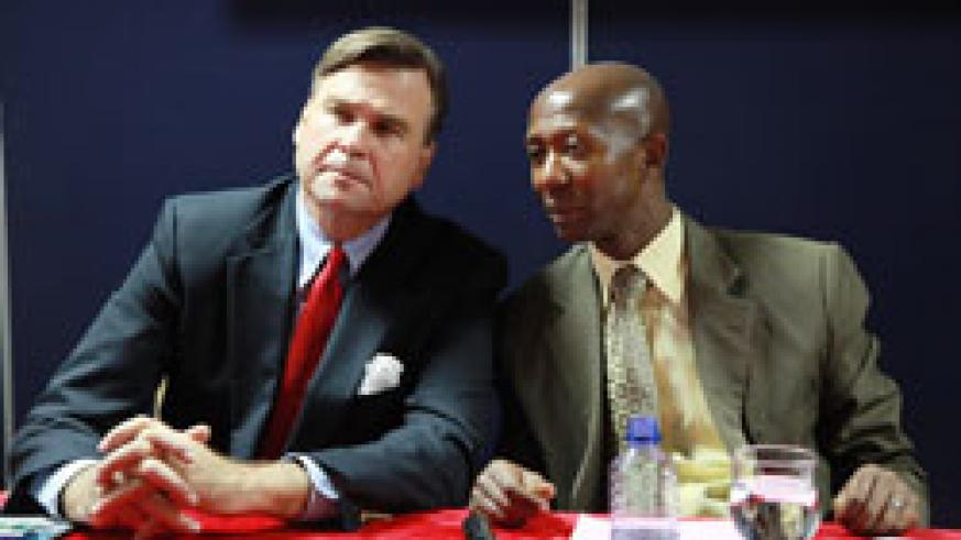 US Ambassador Stuart Symington and Internal Security Minister Musa Fazi Harelimana during the launch of Citizen's charter.(Photo T Kisambira)