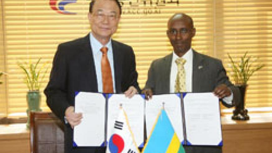 Choi See Joong, the Chairman of KCC-South Korea with Ignace Gatare the Minister in President's office in charge of ICT after signing the cooperation agreement (Courtesy photo)
