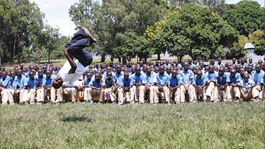 A Karate student shows Parents and his fellow students some of his acrobatic skills during the graduation ceremony