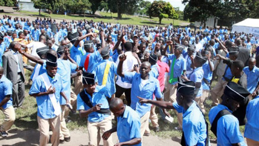 Students dance to the beats of with Patrick Bibarwa Kitoko during the ceremony
