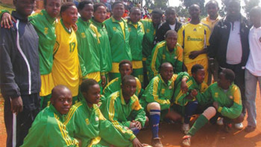 Some of the Team members of Groupe Scolaire Remera Rukoma, posing with a trophy after FEASSSA. (File Photo)