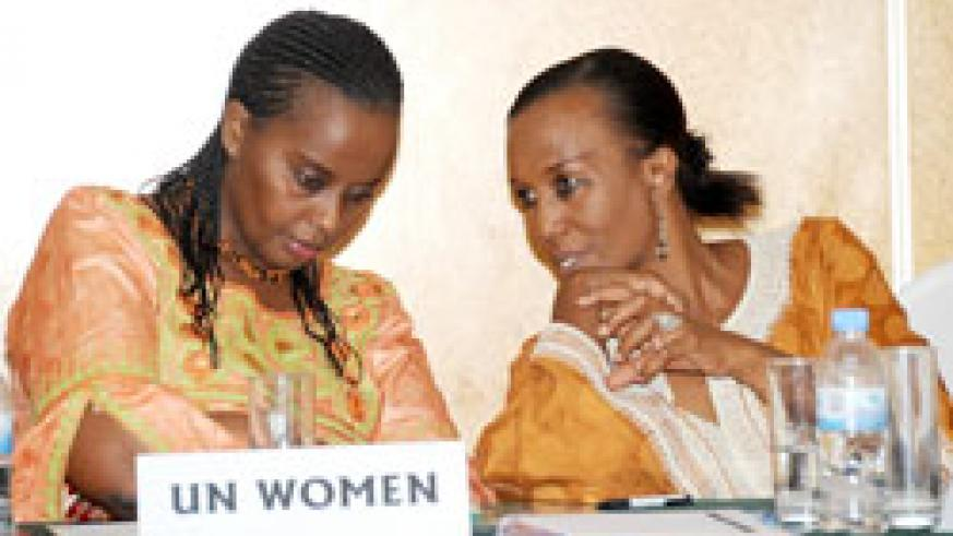 Dona Kamashazi (L) listens to Zaina Nyiramatama of Haguruka during the meeting (Photo; J. Mbanda)