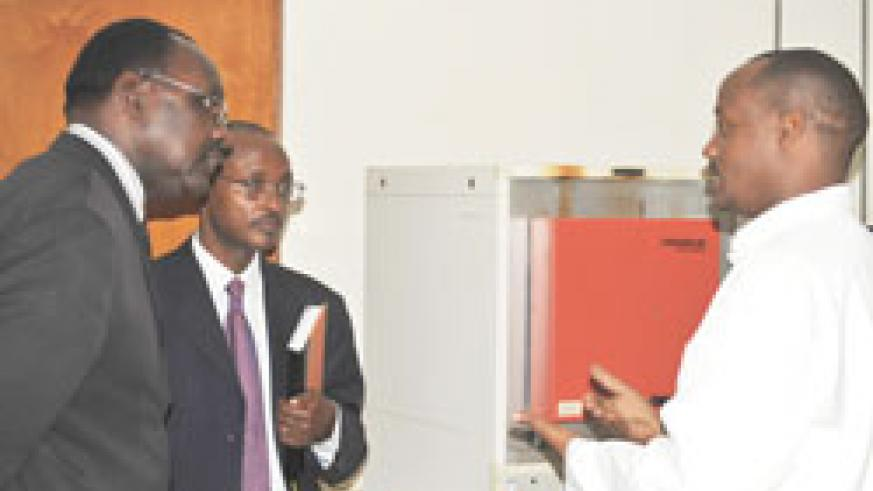 The Minister of Commerce, Francois Kanimba (Left) with Mark Cyubahiro and are taken around the RBS headquarters by a technician (Photo; E. Kabeera)