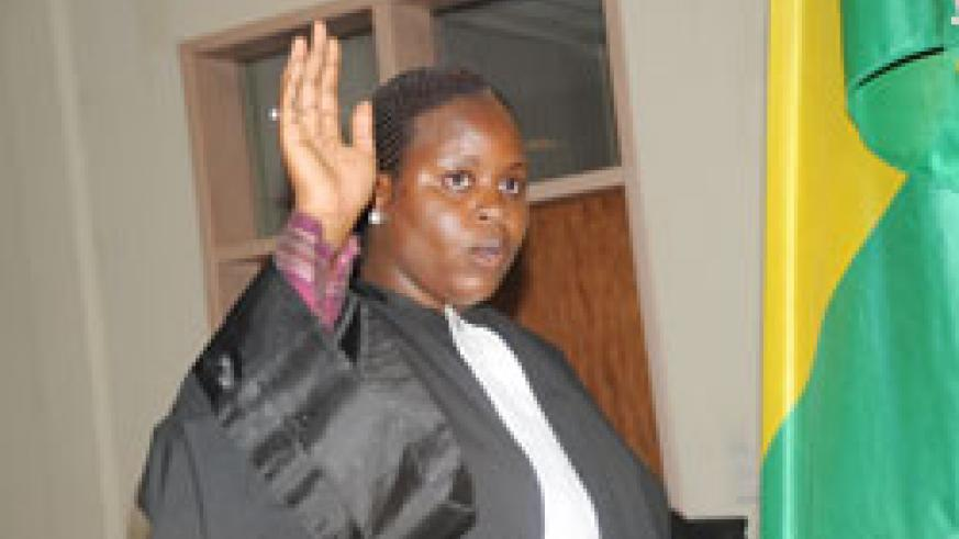 One of the lawyers takes oath prior to joining the Bar Association (Photo J Mbanda)