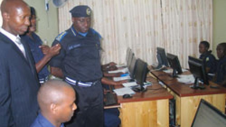 Minister Harerimana and Police chief Gasana tour the new traffic IT facilities. (Courtesy Photo)